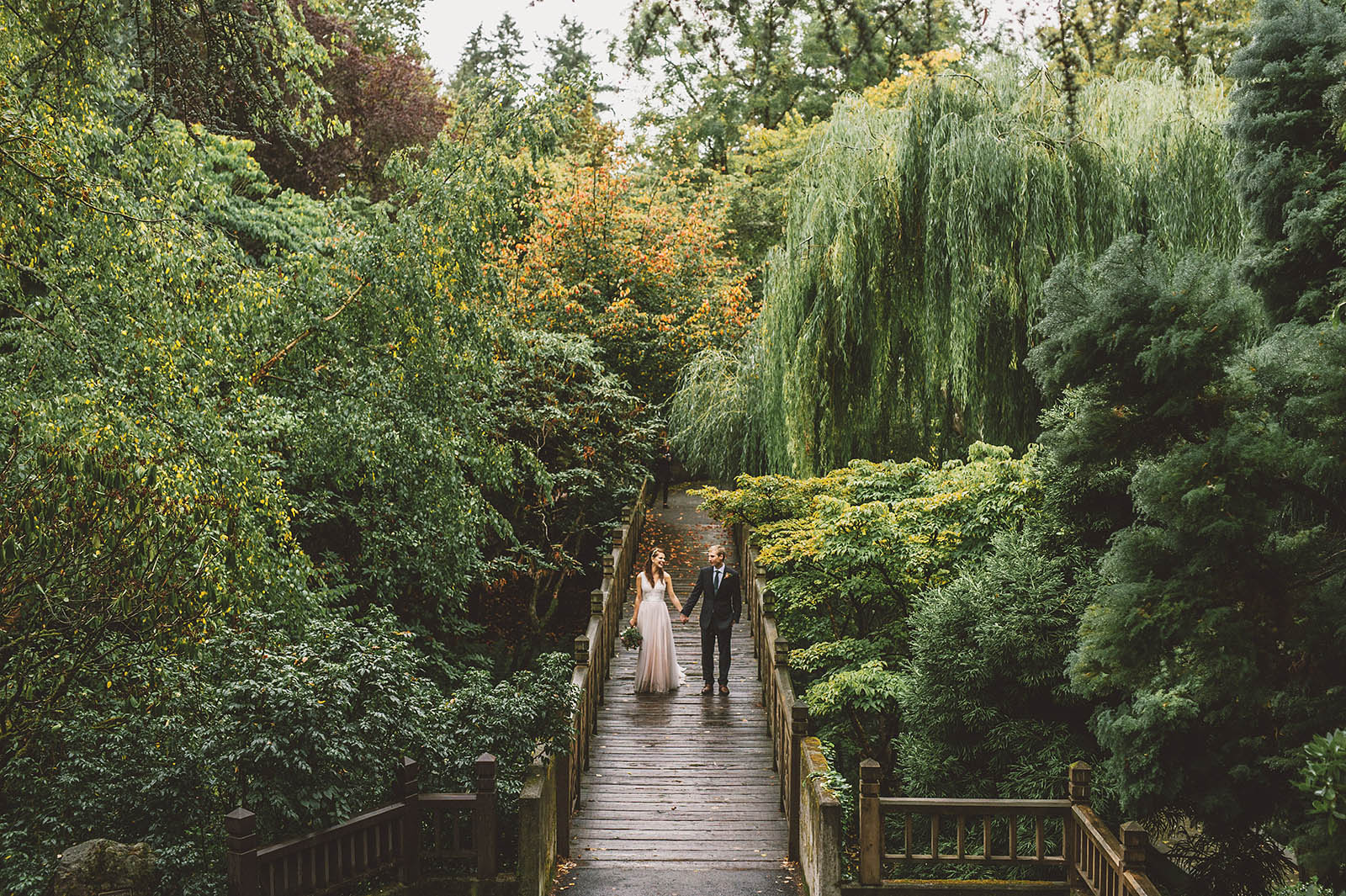 Portraits of Bride and Groom on the bridge at Crystal Springs Rhododendron Garden