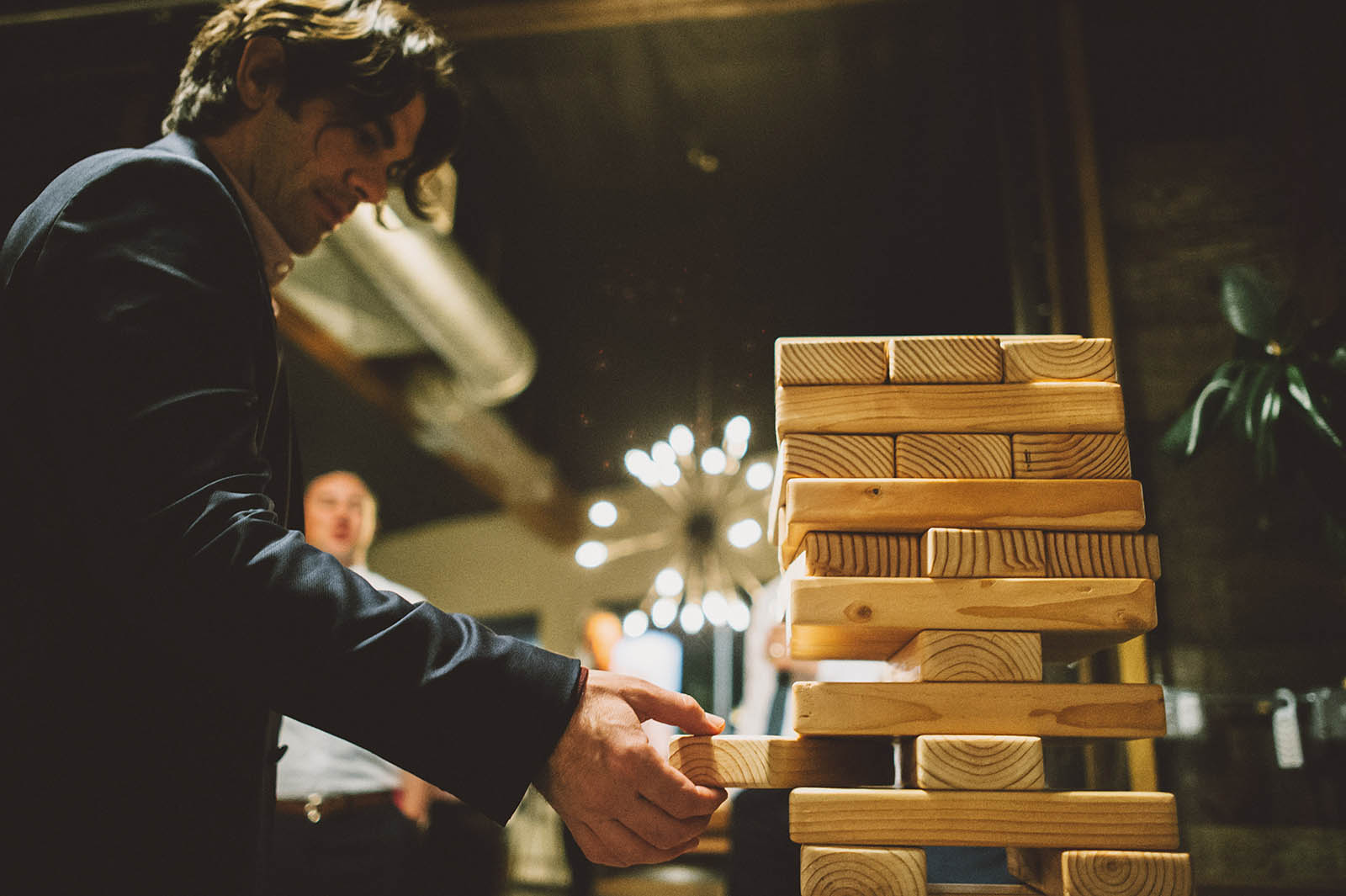 Guests playing giant Jenga at a Clay Pigeon Winery wedding reception
