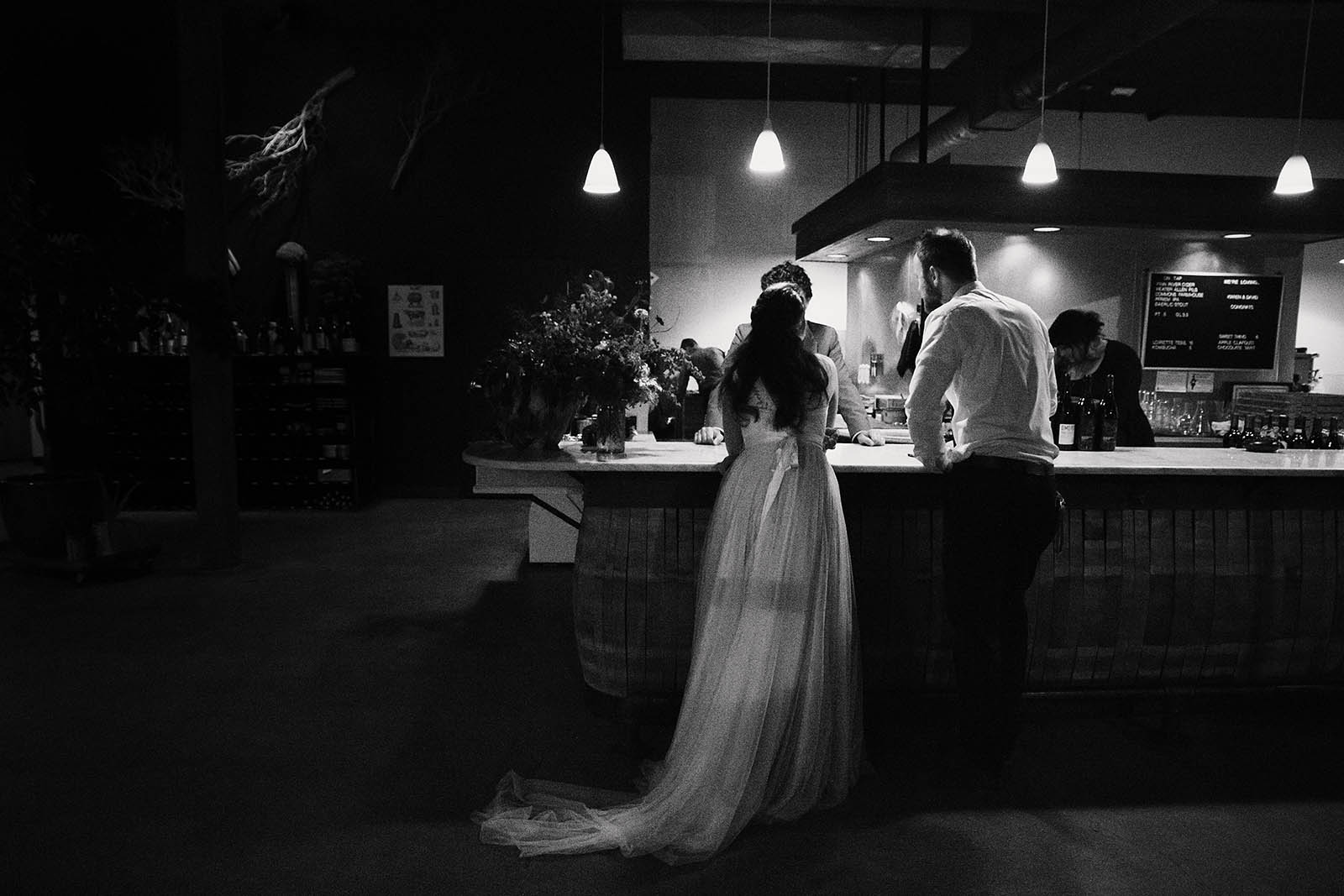 Bride and groomsmen at the bar | Clay Pigeon Winery wedding