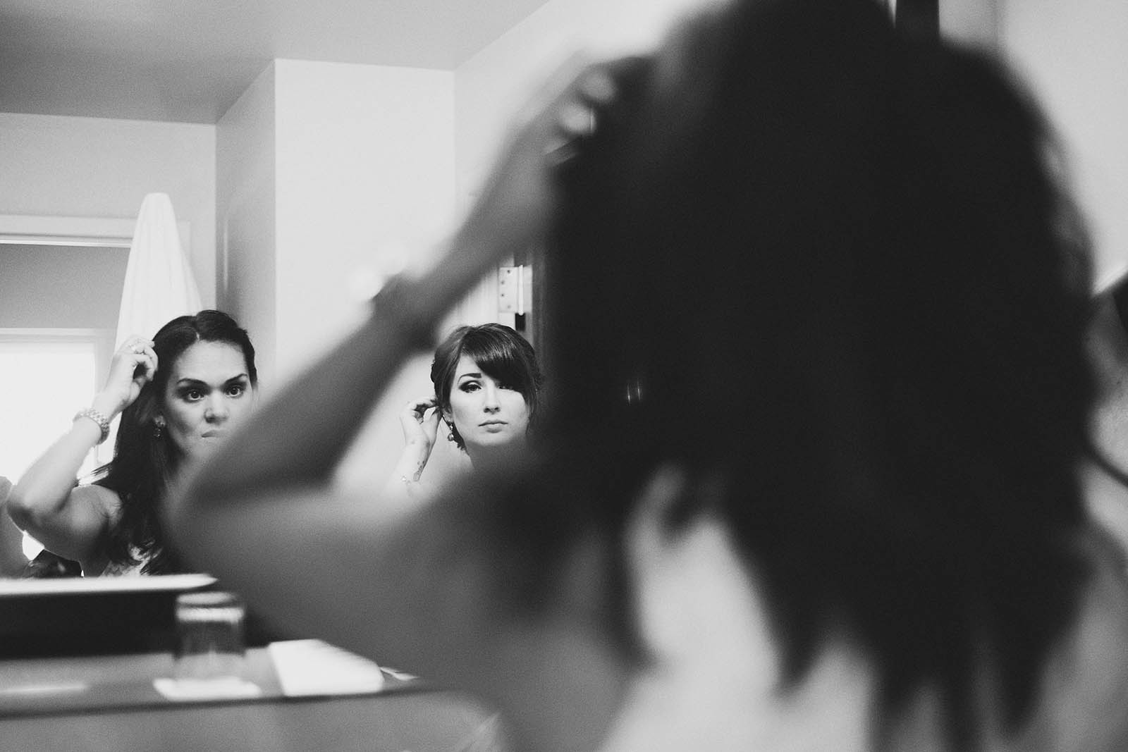 Bride and maid of honor putting on makeup | Cathedral Park Wedding