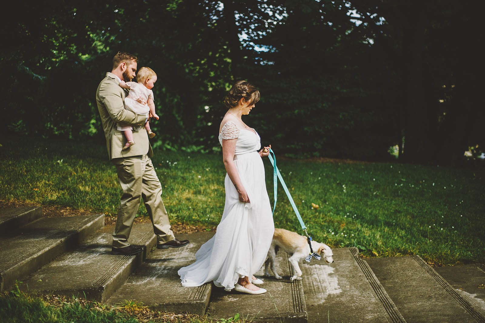 Bride, Groom, their baby and their dog | Cathedral Park Wedding