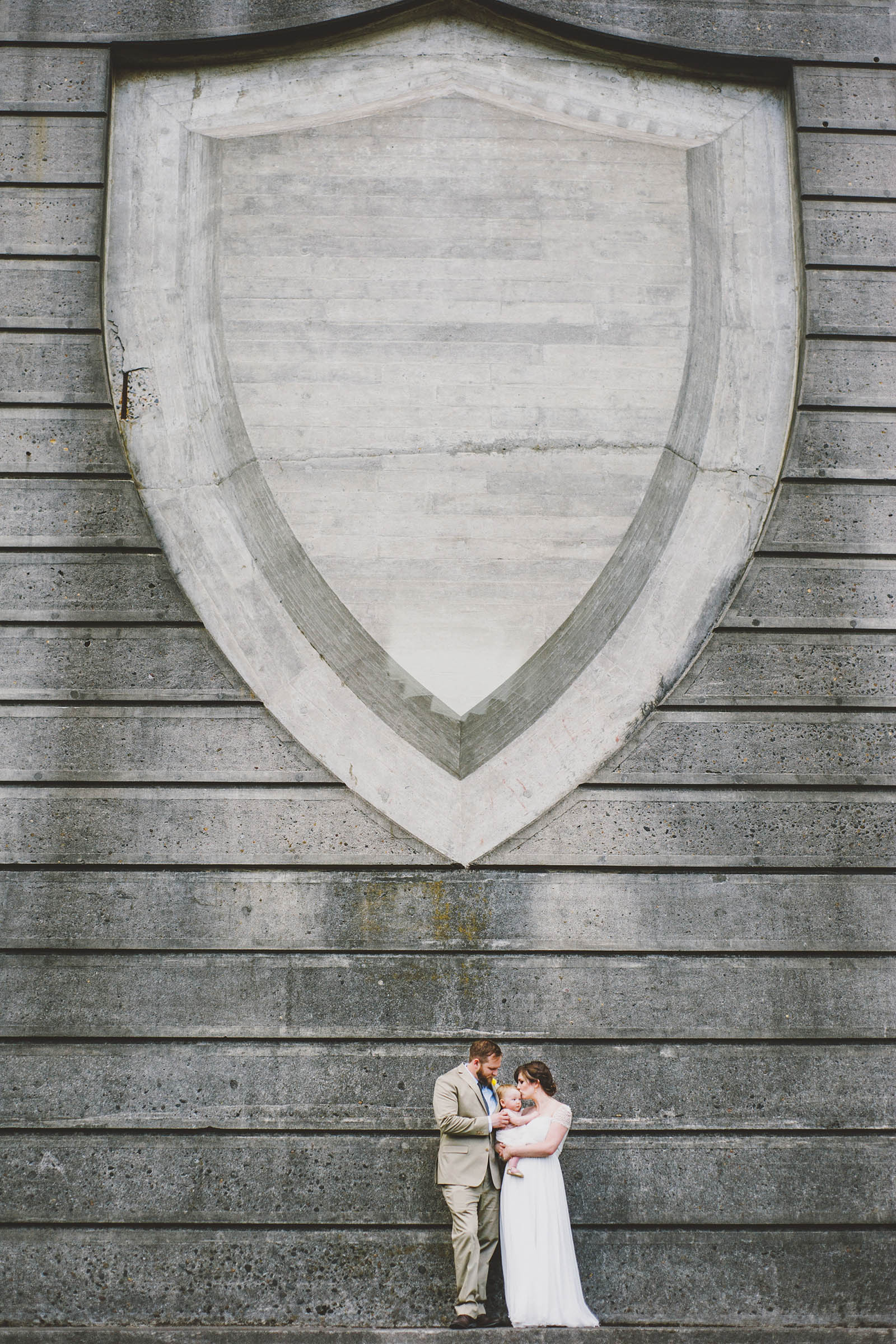 Bride, Groom and their baby | Cathedral Park Wedding