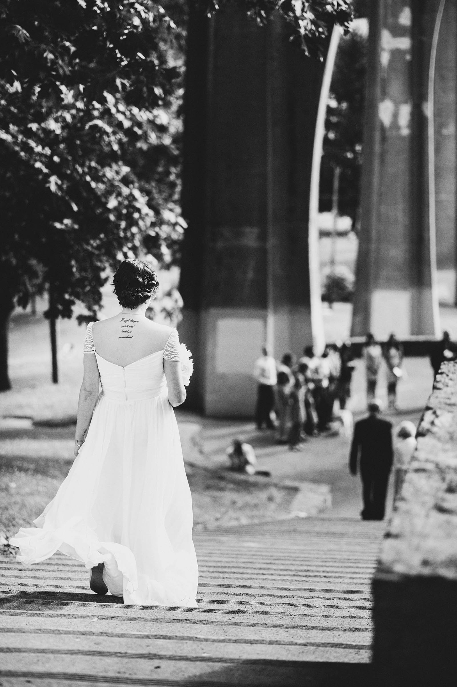 Bride walking down the steps during the ceremony | Cathedral Park Wedding