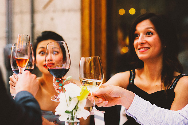 Guests toasting with wine at a Foreign Cinema Wedding