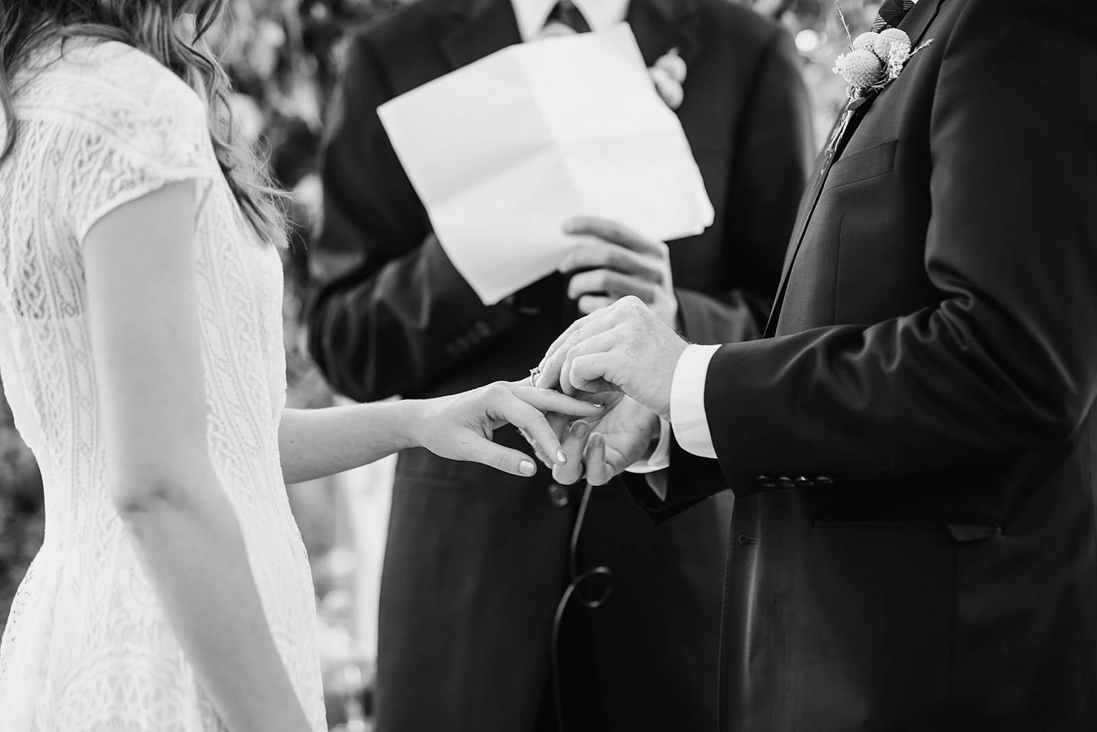 Bride and groom exchanging rings | Castaway Portland Wedding