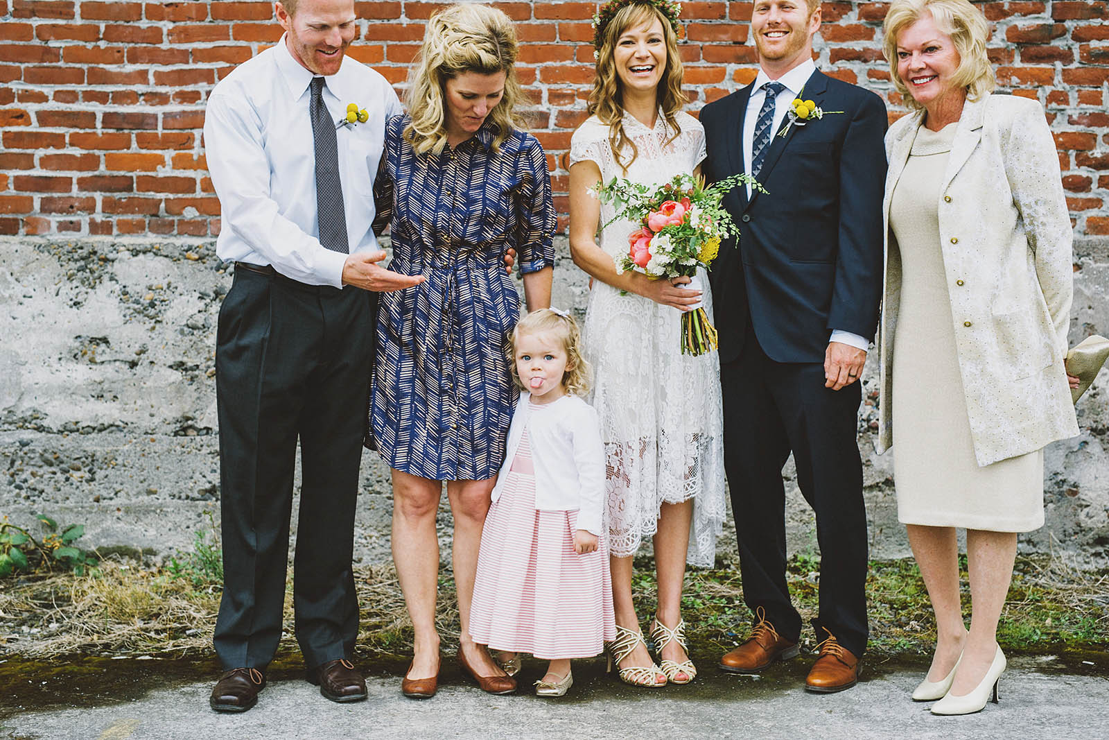 Little girl sticking out her tongue during formals | Castaway Portland Wedding