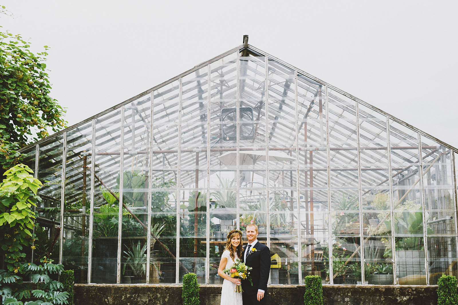 Portrait of bride and groom in front of greenhouse | Castaway Portland Wedding