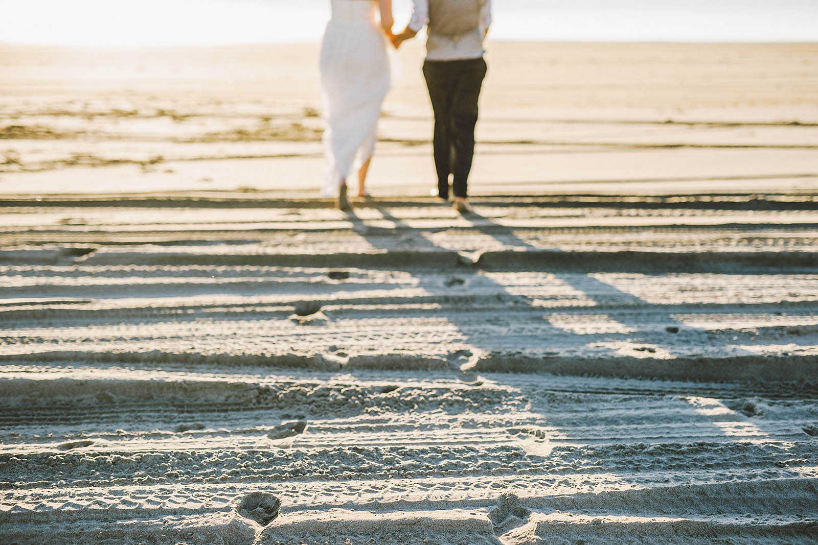 Footsteps in the sand | SouWester Lodge Wedding