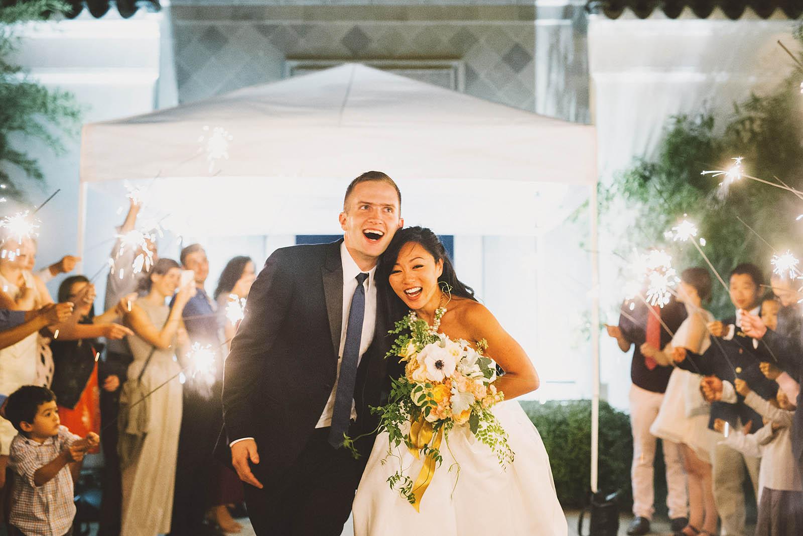 Bride and groom running down their sparkler exit | Lan Su Chinese Garden Wedding