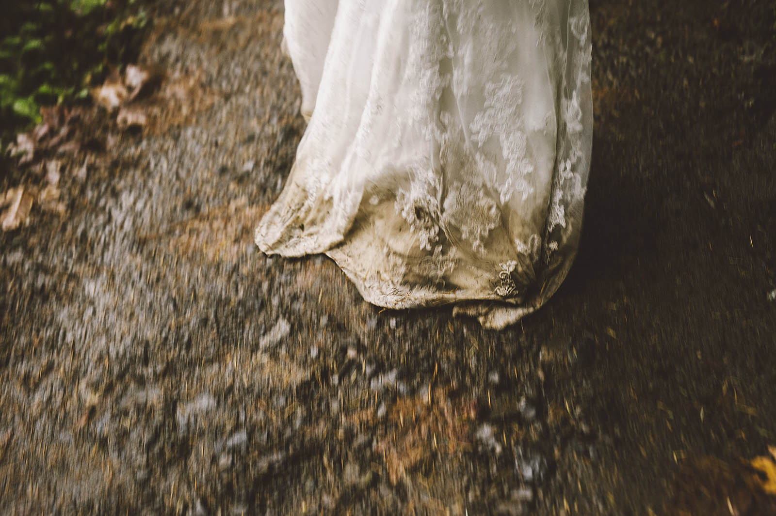 Bride walking the muddy trail | Wahclella Falls Elopement