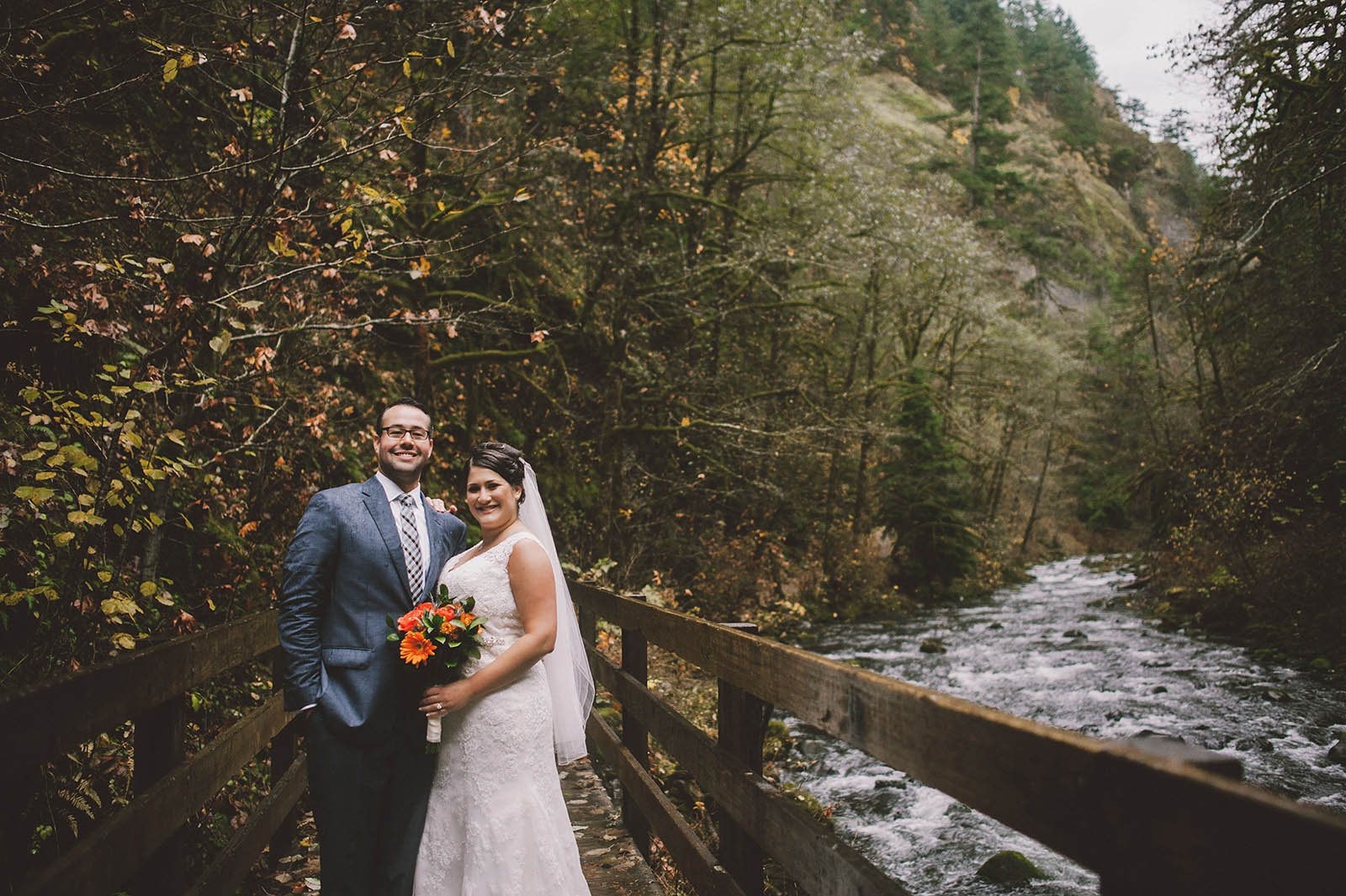 bride and groom on the trail bridge | Wahclella Falls Elopement