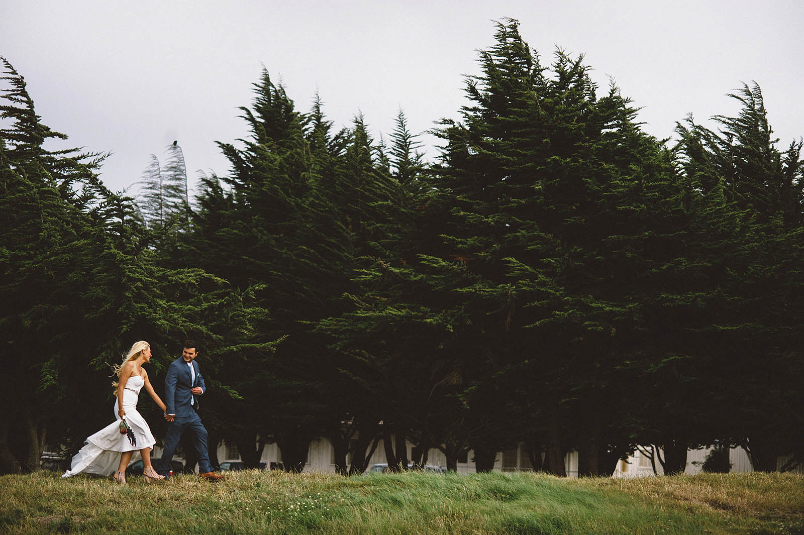 Couple walking out to see the Golden Gate Bridge | San Francisco City Hall Wedding