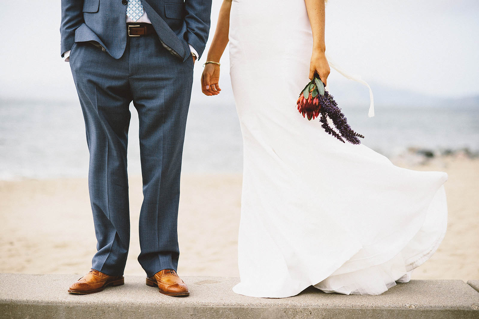 Bride and Groom standing on the beach | San Francisco City Hall Wedding