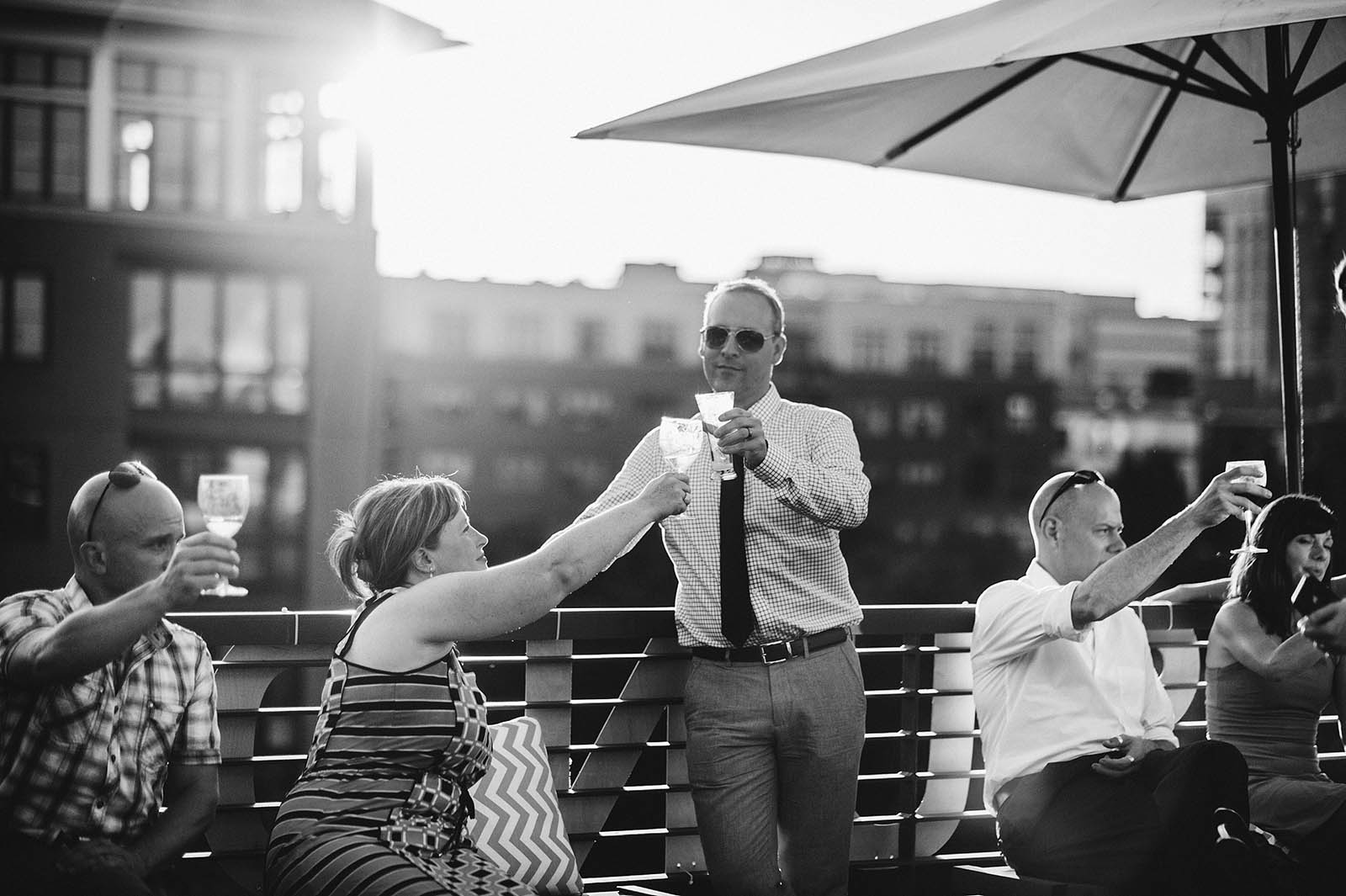 Guests toasting during the speeches | Ecotrust Rooftop Wedding in Downtown PDX