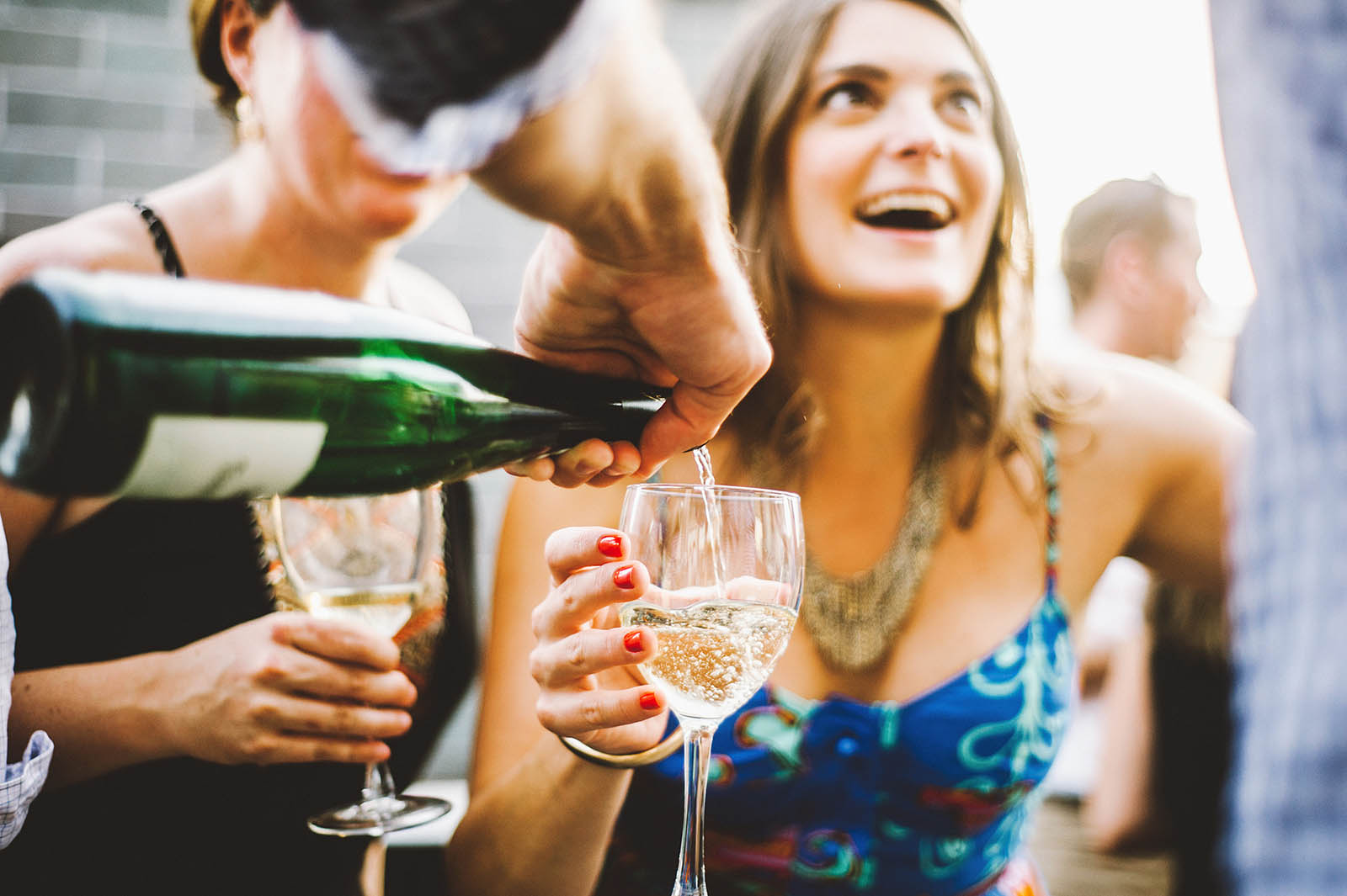 Wedding guests pouring champagne | Ecotrust Rooftop Wedding in Downtown PDX