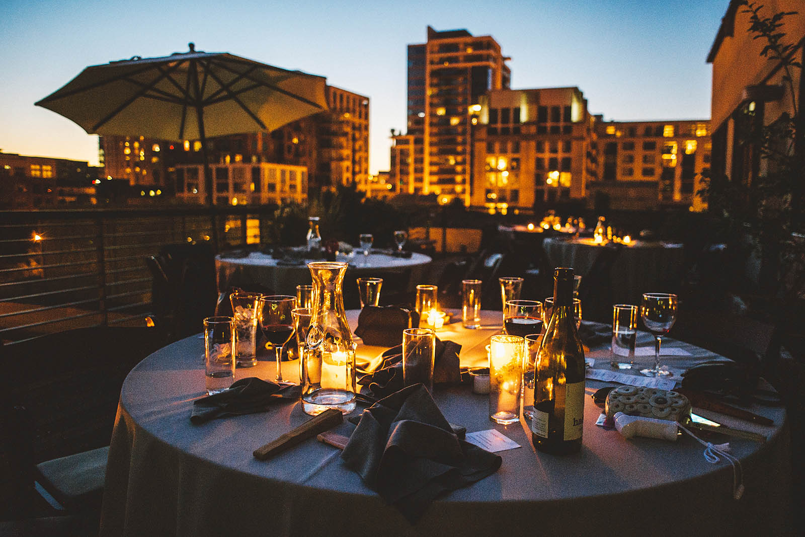 Reception tables at sunset | Ecotrust Rooftop Wedding in Downtown PDX