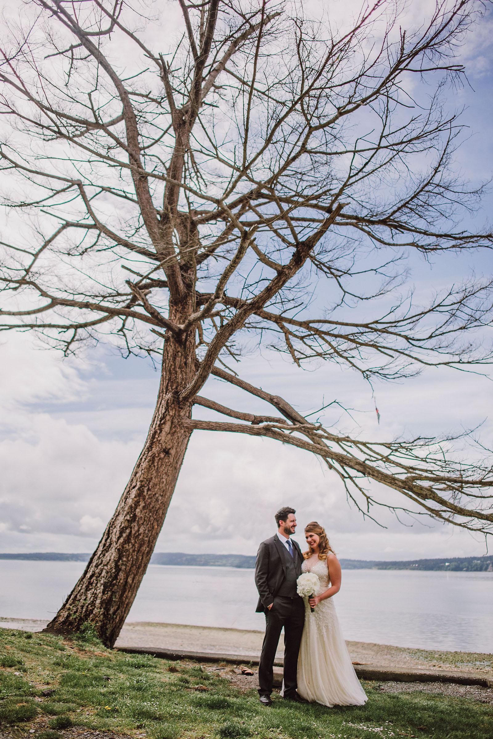 Portrait of bride and groom under a tree at Cama Beach State Park | Camano Island Wedding