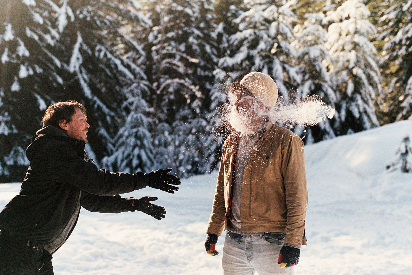 Amos throwing snow on Miles in Trout Lake, WA | Contax Aria