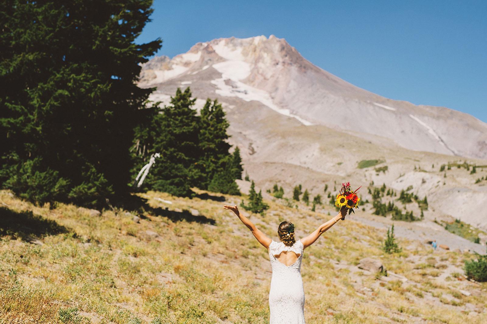 Bride waving hello to Mt Hood | Mazama Lodge Wedding