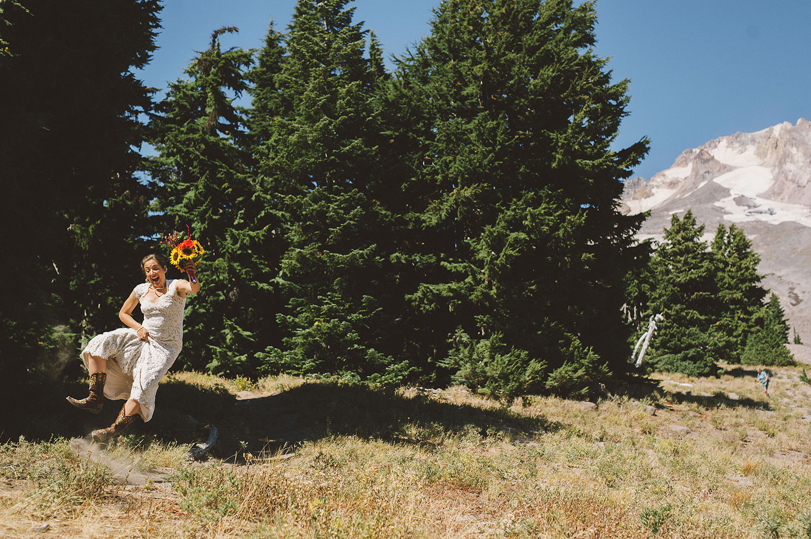 Bride jumping and clicking her heels together | Mazama Lodge Wedding