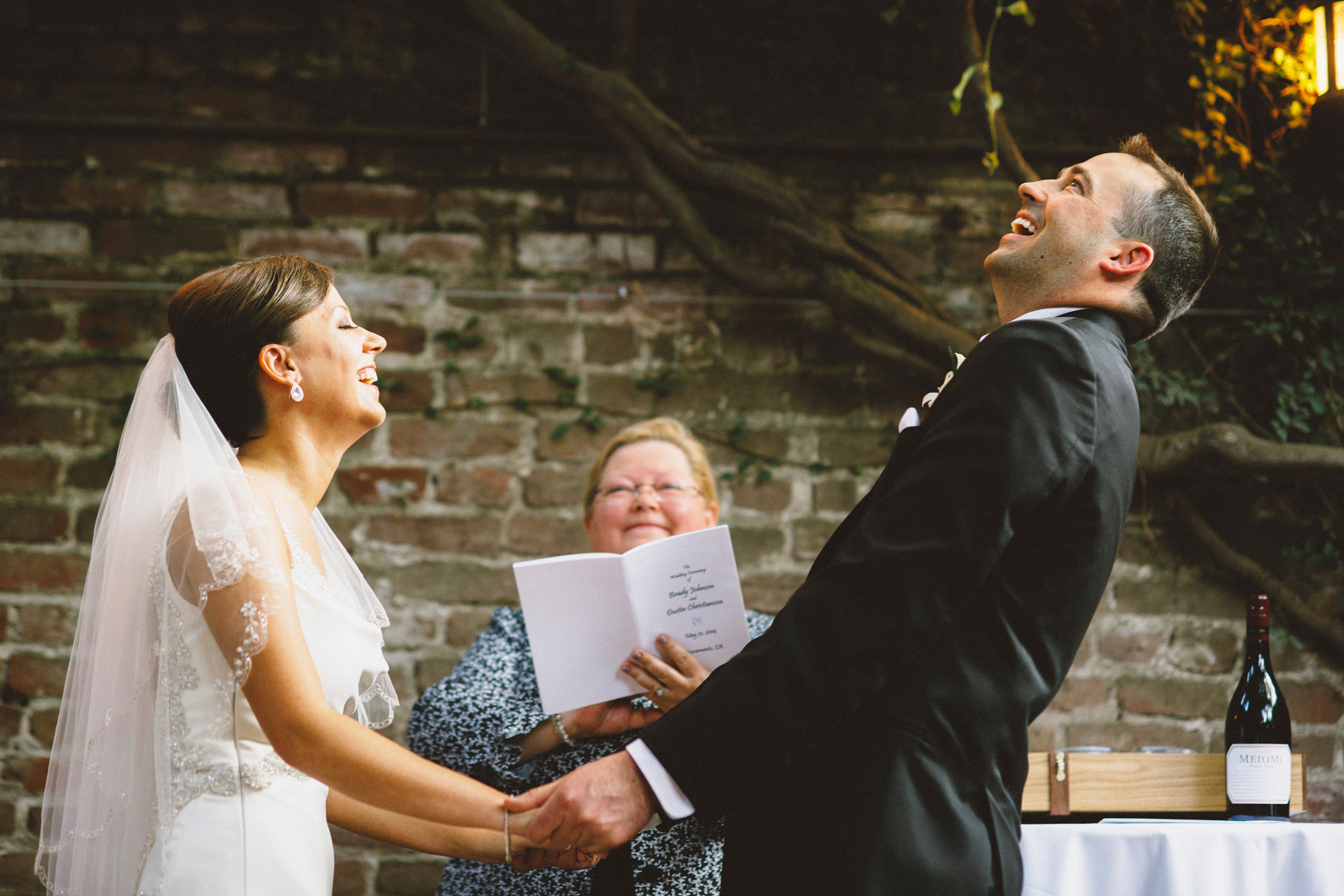 Bride and Groom laughing at the officiant | Sacramento Firehouse Wedding