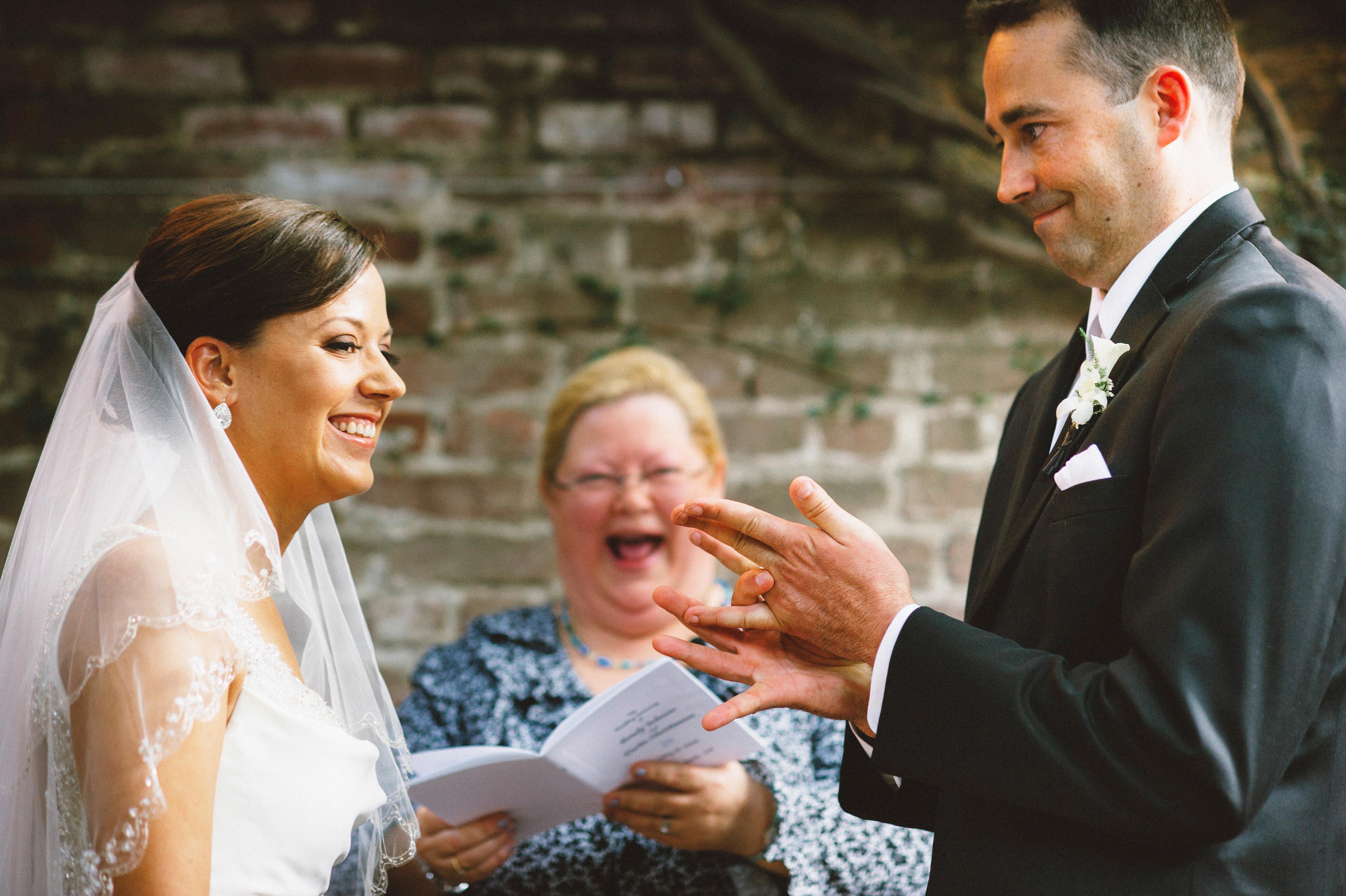 Groom shoving his ring on | Sacramento Firehouse Wedding