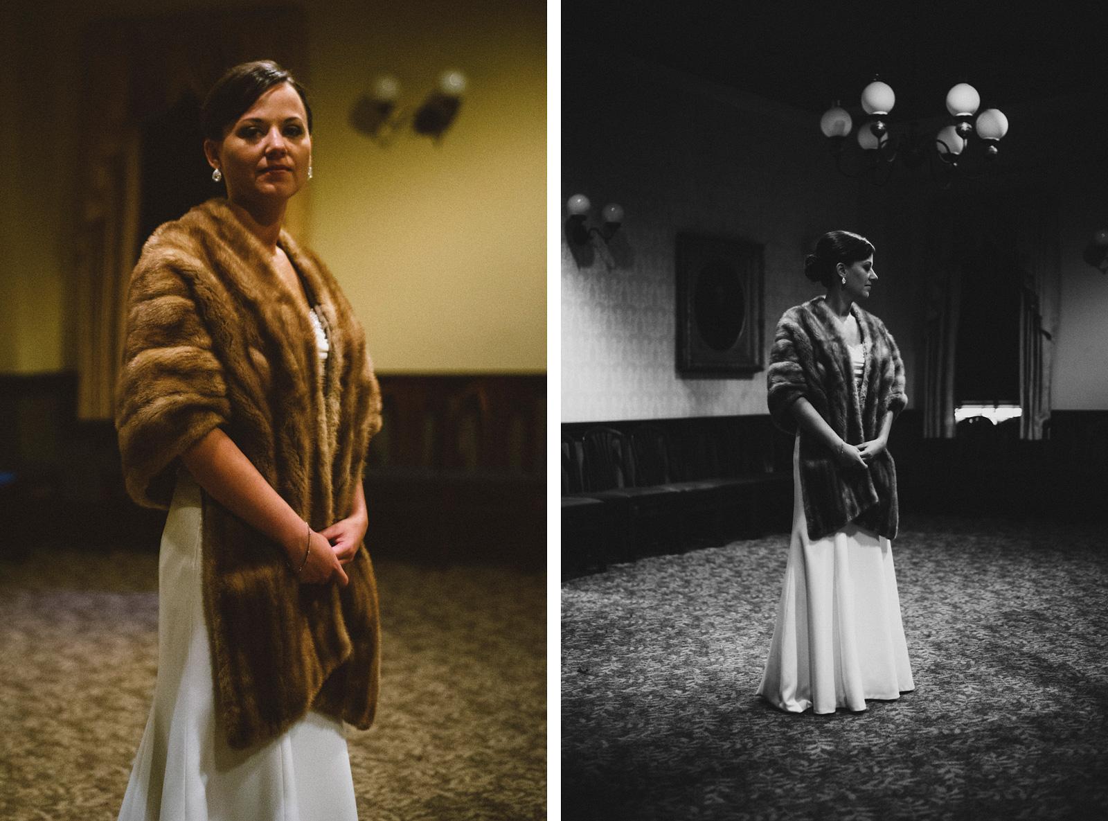 Bride posing inside restaurant wearing fur coat | Sacramento Firehouse Wedding