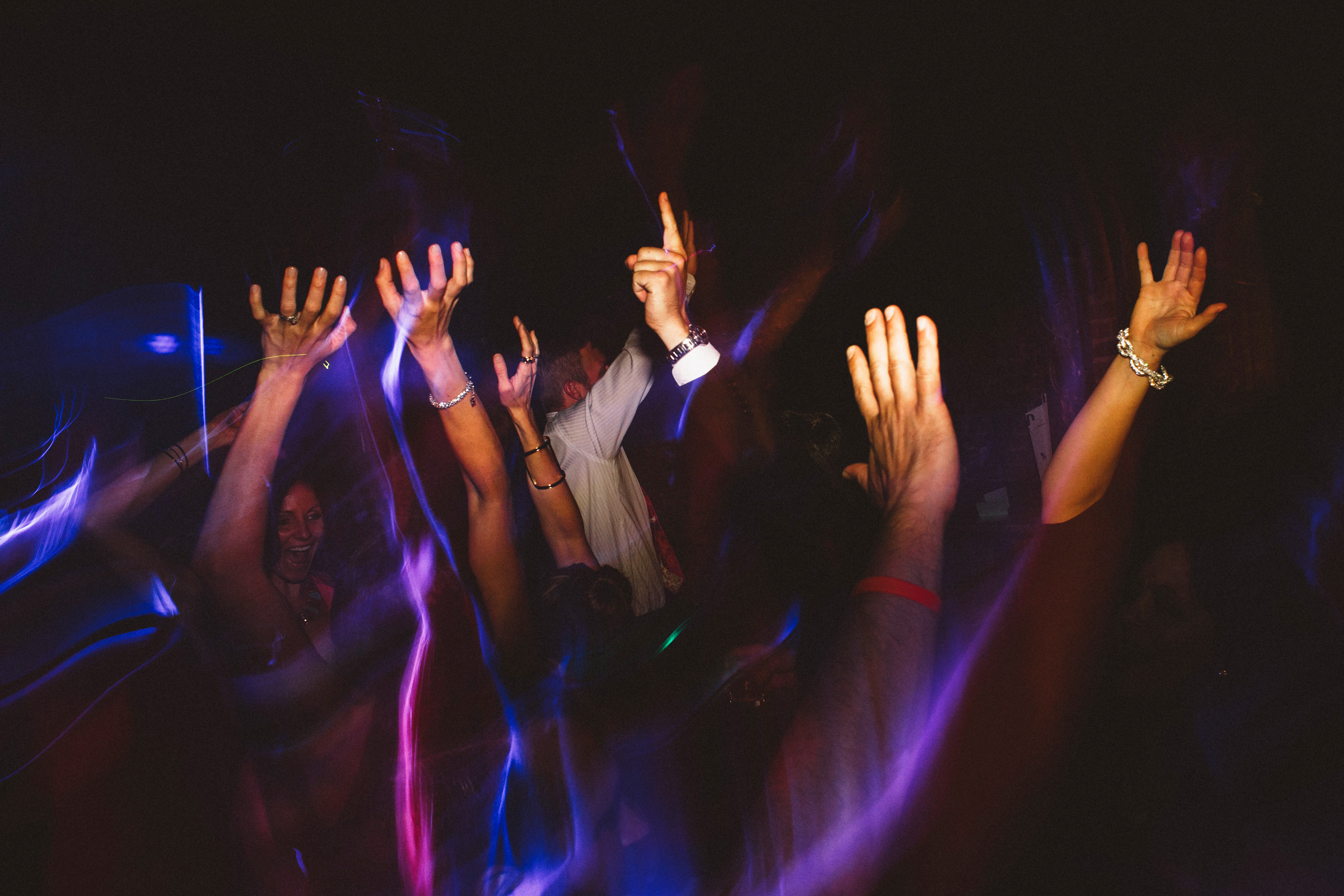 Hands in the air on the dance floor | Sacramento Firehouse Wedding
