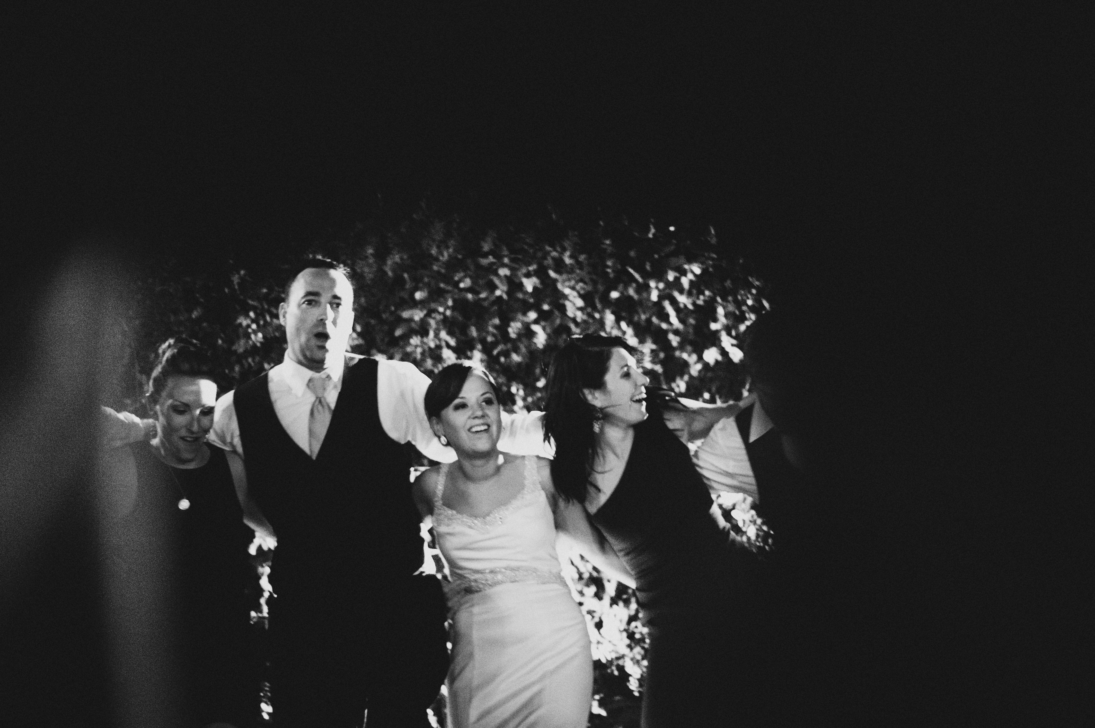 Bride and Groom singing with guests in a circle | Sacramento Firehouse Wedding