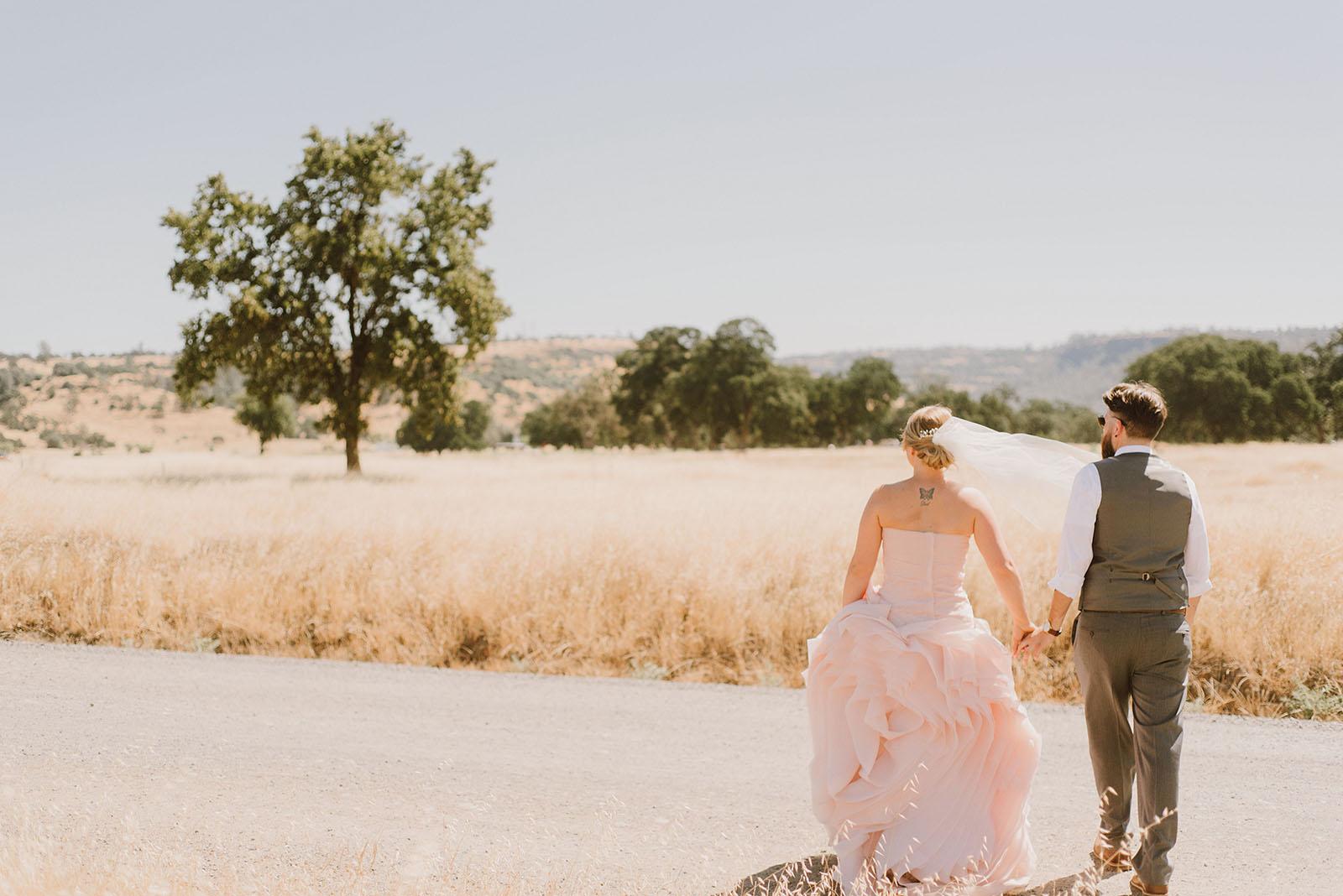Bride and Groom walking through Upper Bidwell Park | Backyard Chico California Wedding