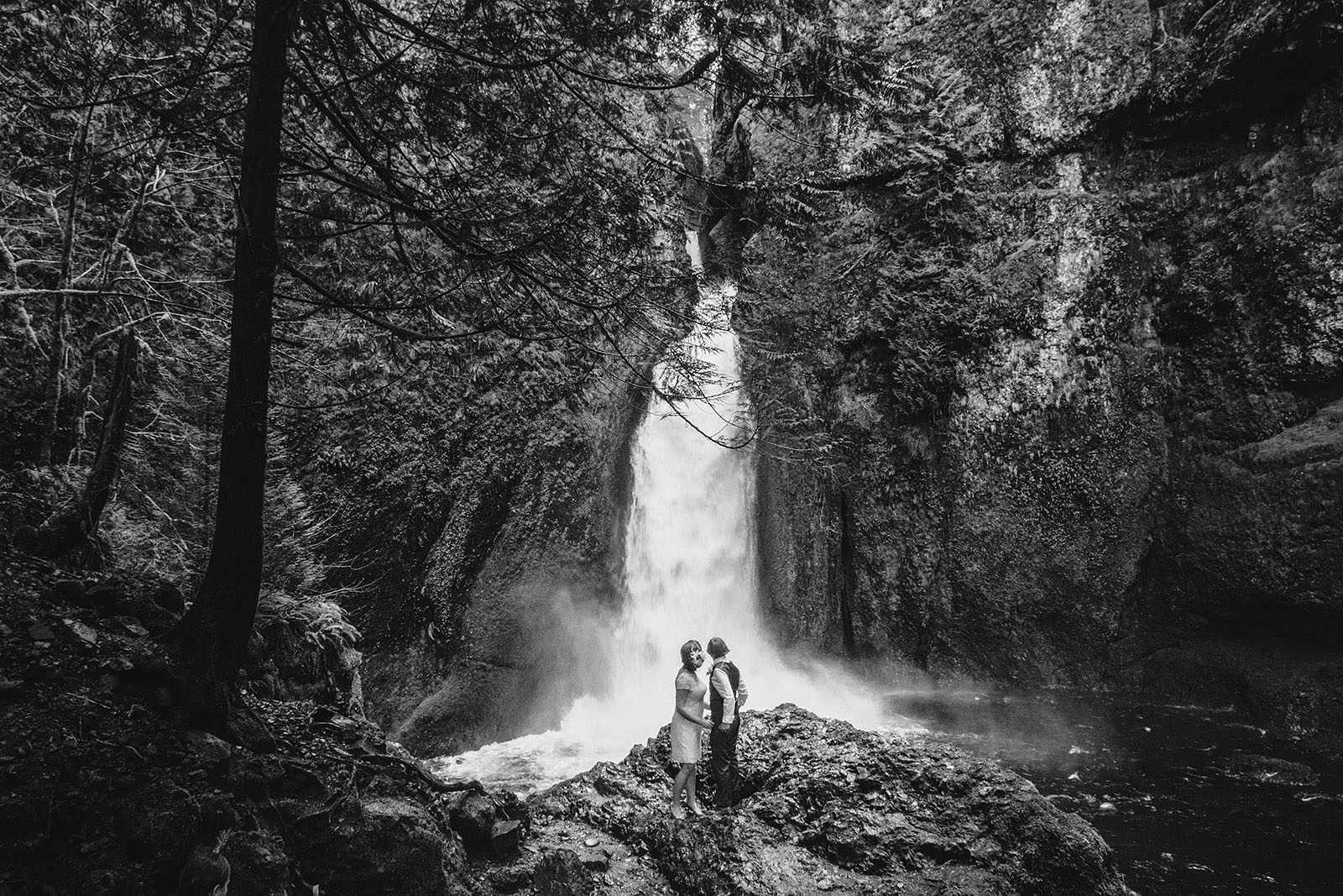 Brides hugging at ceremony site | Wahclella Falls Wedding