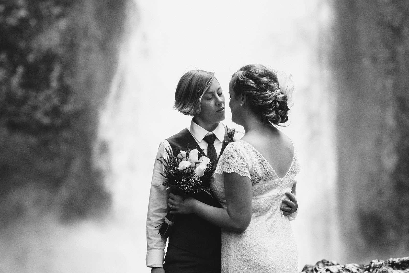 Brides embracing before ceremony | Wahclella Falls Wedding