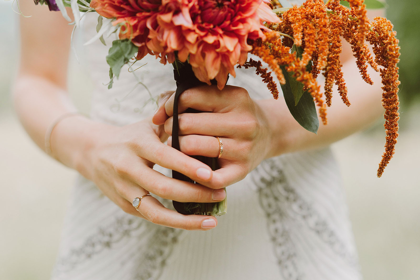 Bride's bouquet and wedding rings | Woodsy Campground Wedding