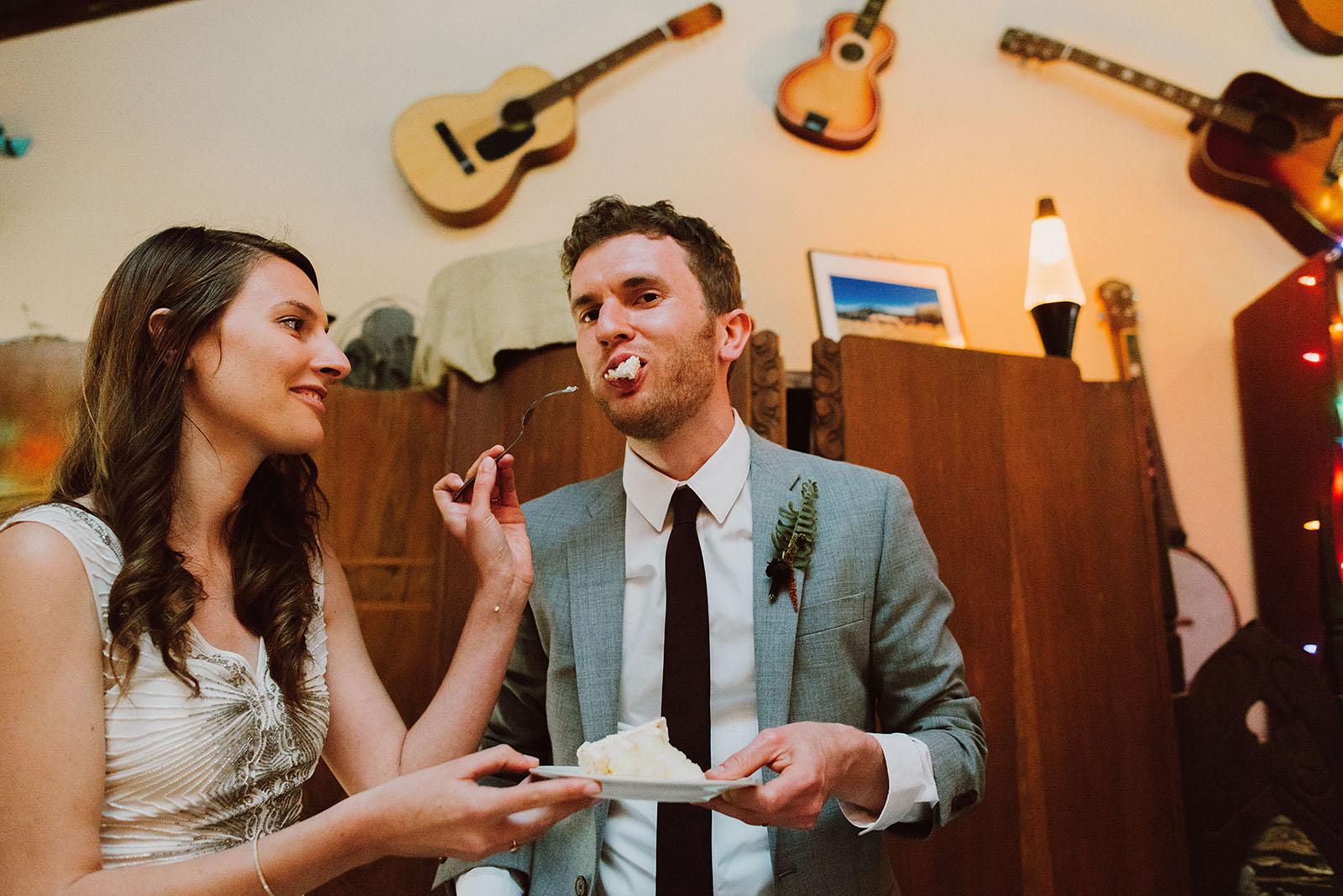 Cake cutting inside the Galaxy Barn | Woodsy Campground Wedding