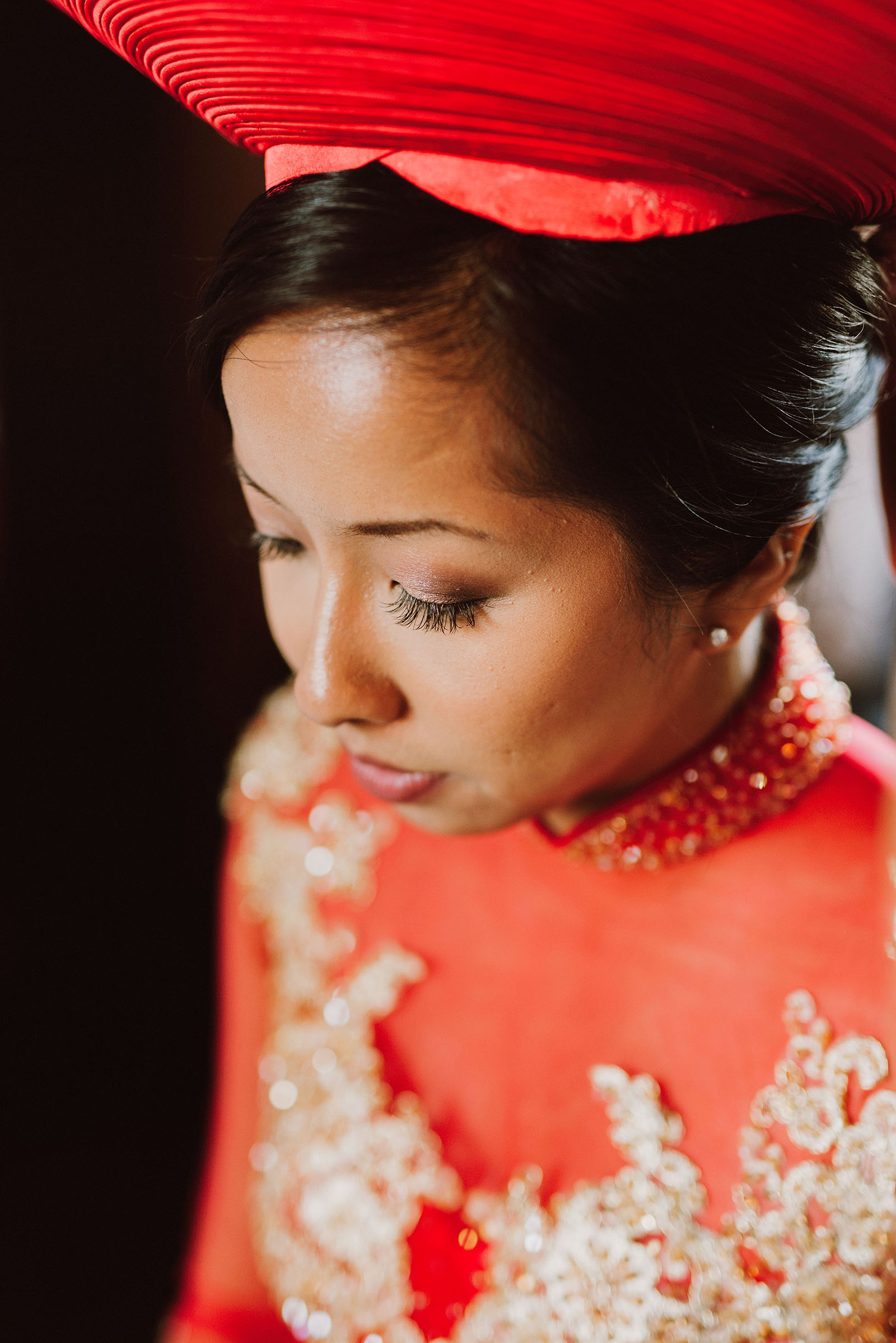 Bride getting dressed in traditional Vietnamese gown and hat | Portland Castaway Wedding