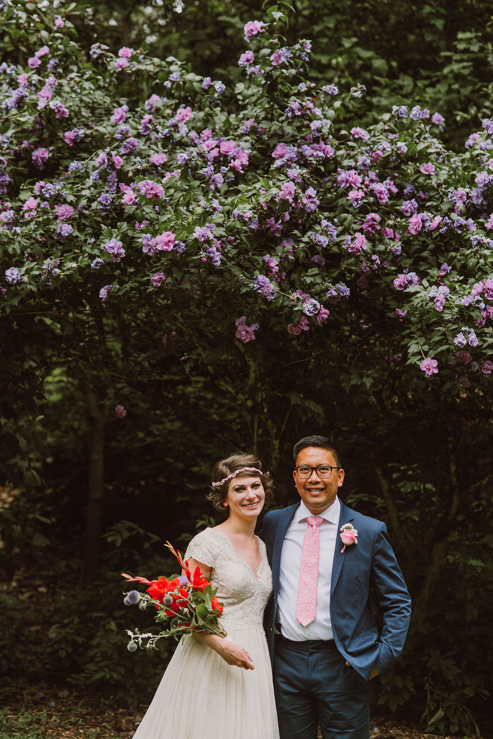 Bride and Groom portrait with blooming flowers in Laurelhurst Park | Downtown Portland Elopement
