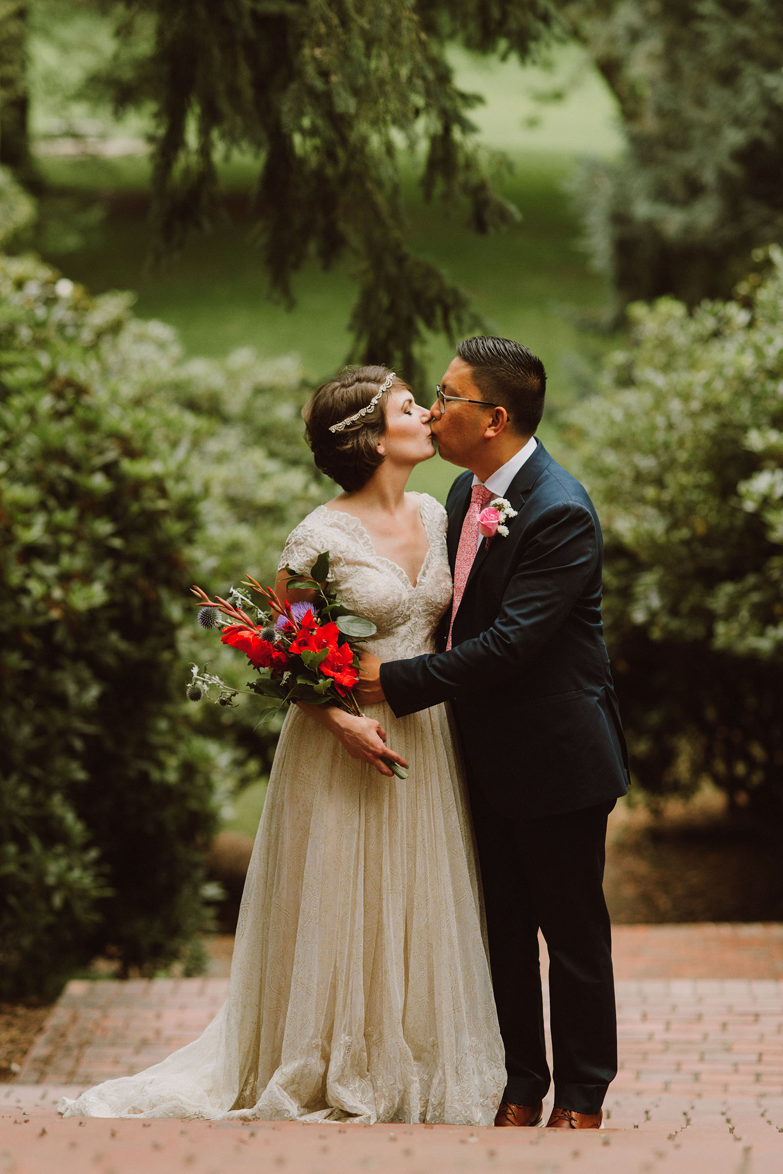 Bride and Groom kissing on the steps in Laurelhurst Park | Downtown Portland Elopement