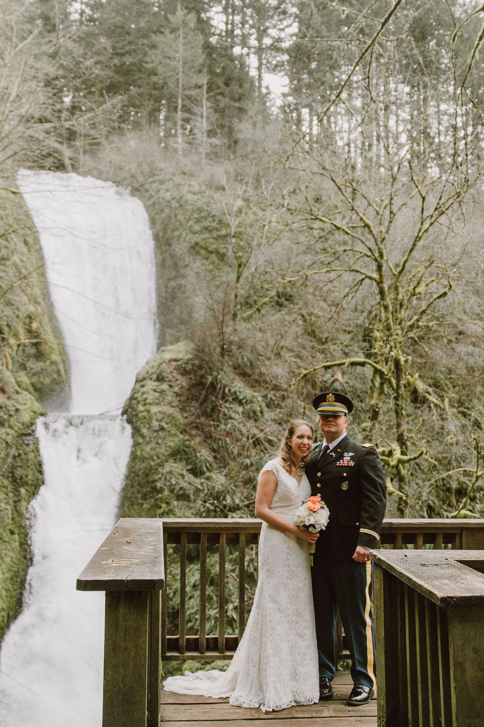 Bride and Groom posing in front of a waterfall | Bridal Veil Elopement Photographer