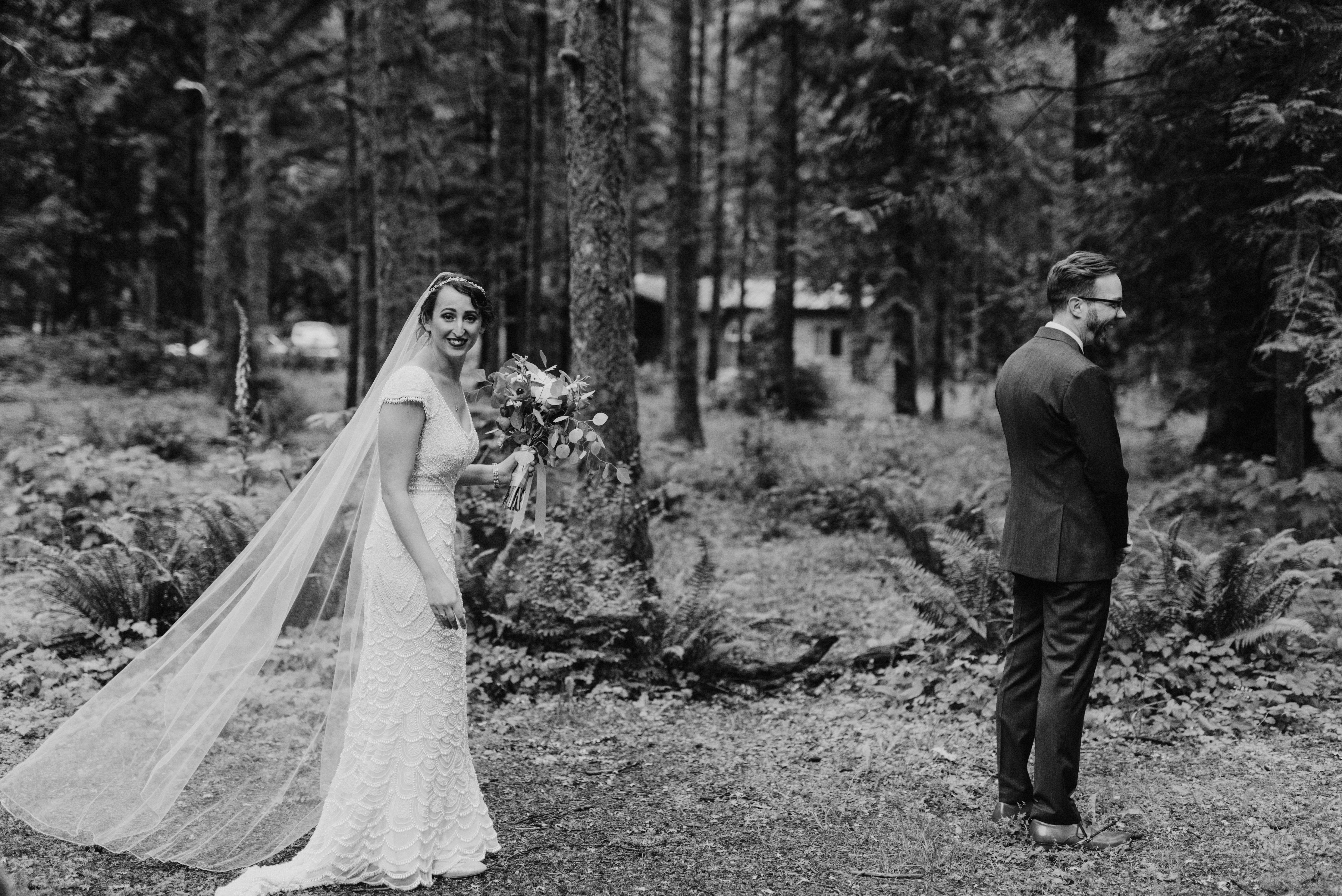 Bride and Groom's first look in the forest at Camp Angelos wedding