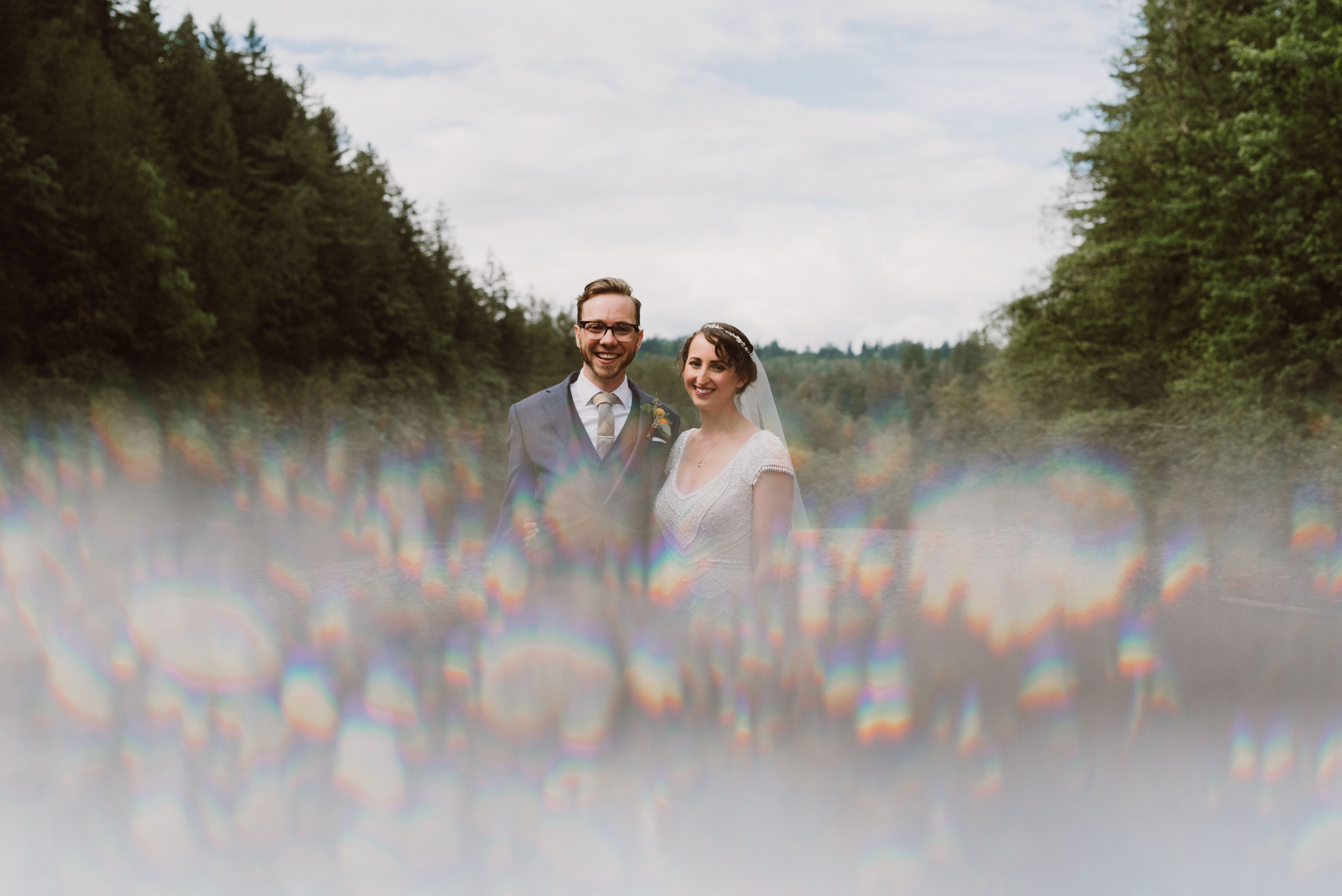 Bride and Groom portraits on the river at Camp Angelos