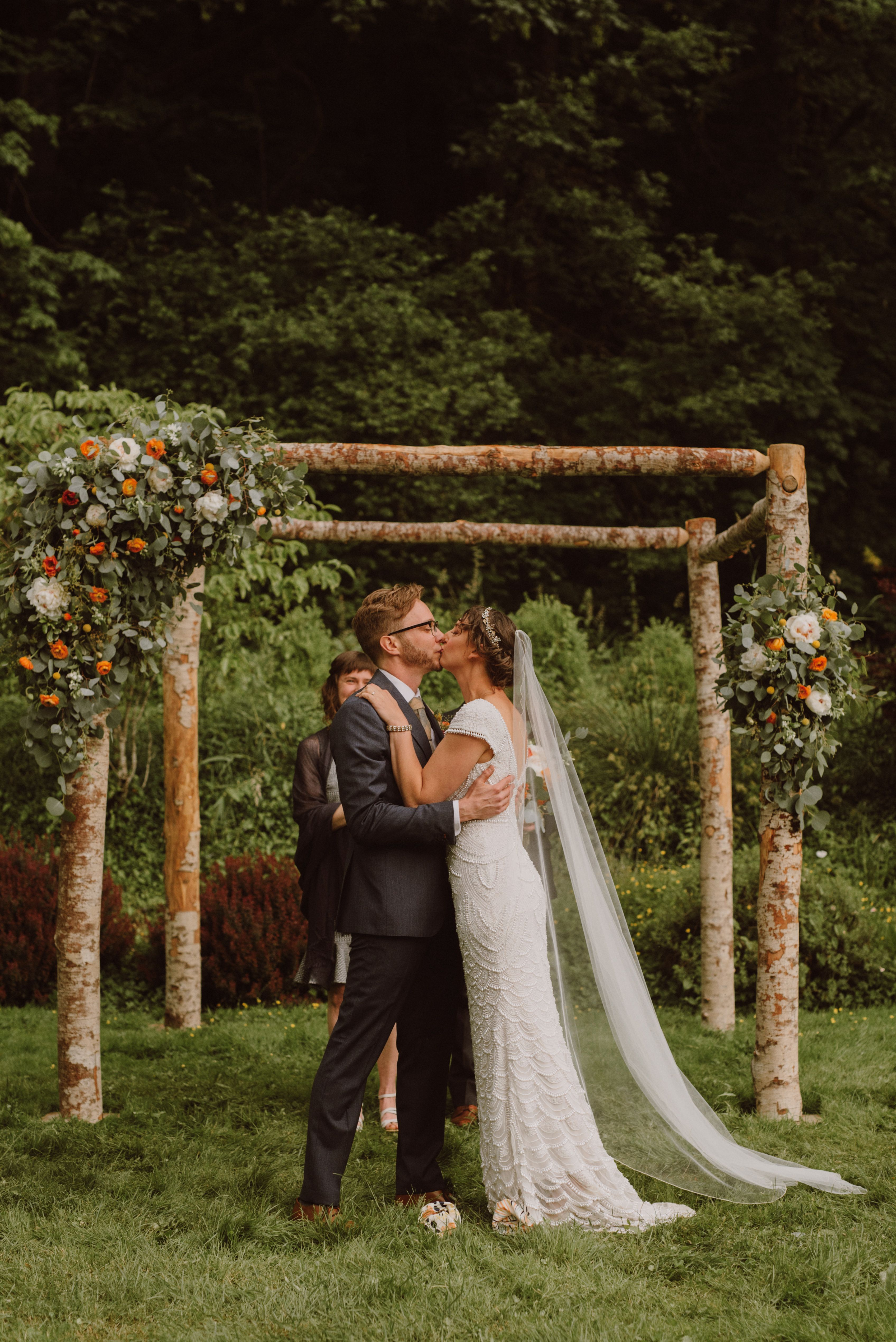 Bride and Groom's first kiss at Camp Angelos wedding