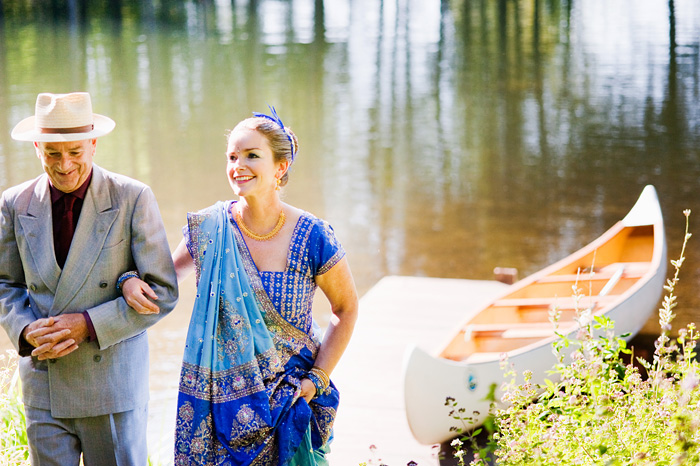 Father of Bride, Robin Cody, arrives in canoe with Bride - Bridal Veil Lakes wedding - Portland Oregon
