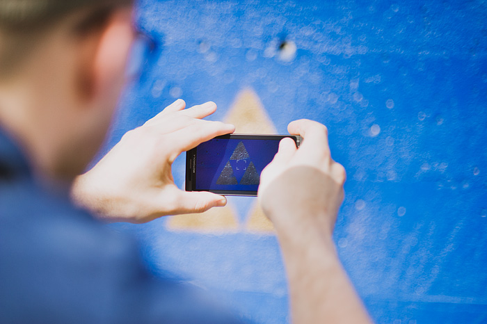 Cory Burnsed photographing Zelda Tri-Force Graffiti