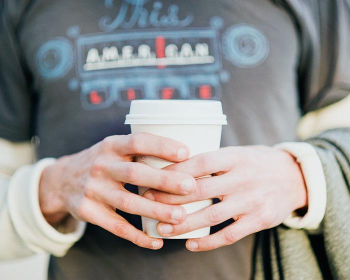 Alan holding Stumptown Coffee