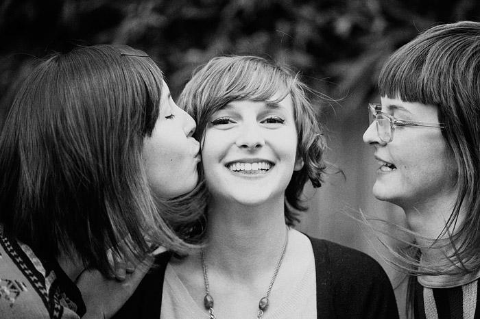 Lara giving Jenica a Kiss - Portland Portrait Photographer