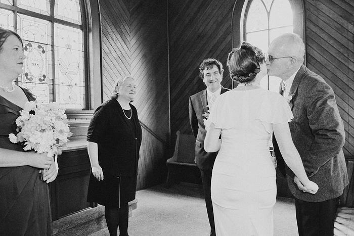Oaks Pioneer Church Wedding Photographer - Father Kisses Bride