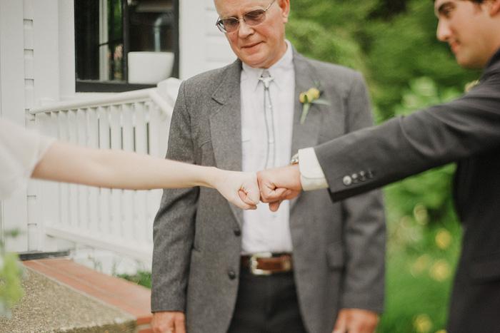 Oaks Pioneer Church Wedding Photographer - Bride and Groom Fistbump