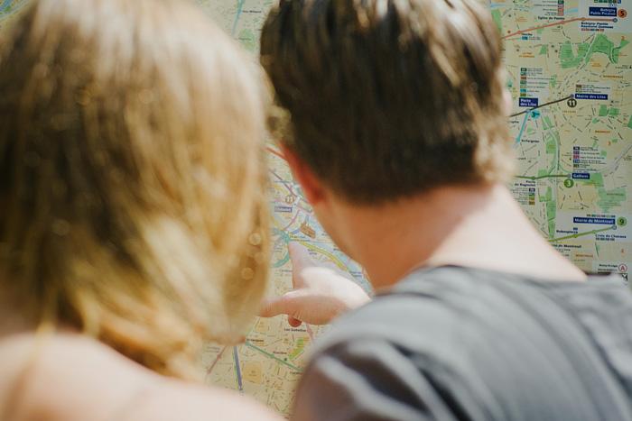 Destination Paris elopement - Couple Looking at Metro Map