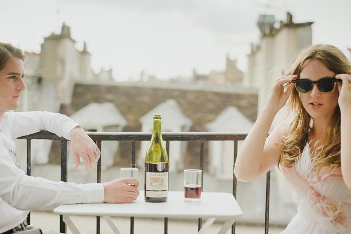 Destination Paris elopement - Newlyweds drinking wine on balcony