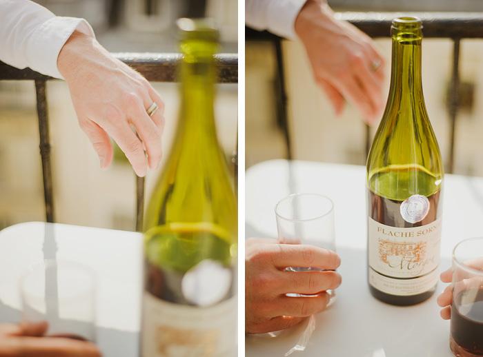 Destination Paris elopement - Groom drinking wine on balcony